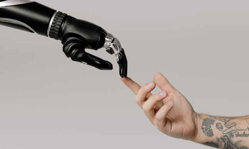 A robotic finger touching a human finger.